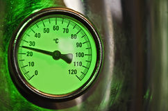 Temperature gauge. With a shiny metallic frame Royalty Free Stock Photography