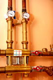 Temperature gauge and taps. Temperature gauge , heating equipment in boiler-room stock photos