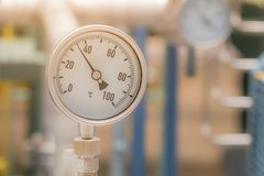 Temperature gauge. In factory on blurred background Stock Images