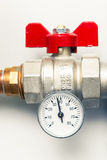 Temperature gauge with water tap Stock Image