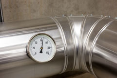 Temperature meter of water pipes. Temperature gauge in order to measure the temperature of the heating royalty free stock photo