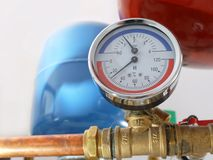 Temperature and pressure gauge. Mounted on boiler pipes Royalty Free Stock Image