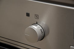 Temperature regulation on new modern home kitchen oven Royalty Free Stock Images