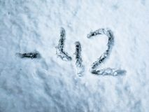 Temperature of -42 written in the freshly fallen snow royalty free stock photo