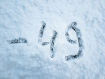 Temperature of -49 written in the freshly fallen snow royalty free stock photos