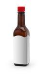 Tempere a garrafa do molho com um Tag vazio no branco Fotos de Stock Royalty Free