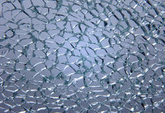 Tempered glass. Broken tempered glass texture at grey background Royalty Free Stock Photos
