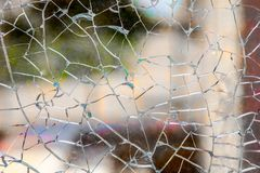 Tempered glass broken cracks splinters on a background. Broken tempered glass close up , background of glass was smashed Stock Photos