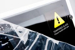 Tempered Glass Warning. On Brand New Computer Case Royalty Free Stock Images