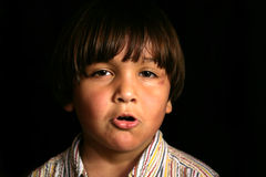 Tempered Kid. Hispanic tempered young child Royalty Free Stock Photo