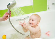 Tempering shower for baby Stock Images