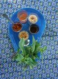 Tempero asiático no foco de vidro pequeno no vegetal Imagens de Stock Royalty Free