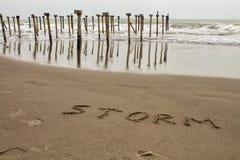 Tempestade do sinal na areia imagem de stock royalty free