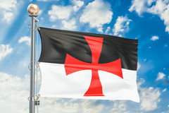Templar knight flag waving in blue cloudy sky, 3D rendering Stock Image