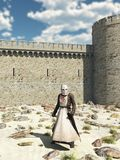 Templar Knight outside the Walls of Antioch. Early Medieval Templar Knight in chain mail and tabard standing in the desert outside the walls of Antioch in the Royalty Free Stock Images