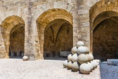 Templar knights castle court with cannonbals Stock Photography