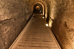 Templar Tunnel in Acco. The Templar tunnel in the old town of Acco, Israel. The Templar tunnel is an underground tunnel residing beneath the town's streets. The Royalty Free Stock Image