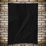 Template- Black crumpled rectangle Poster on grunge brick wall Royalty Free Stock Image