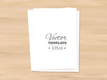 Template of blank paper sheet on a wooden Royalty Free Stock Photo
