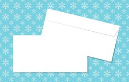 Template blank vector envelopes on Christmas background with snowflakes. Blank white envelopes on a blue background. Stock Images