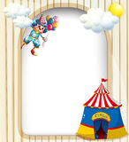 A template with a clown and a circus tent Stock Photo