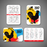Template design pocket calendar 2017 with emblems of Chinese Year  the Rooster. vector illustration. Vertical and. Template design pocket calendar 2017 with Royalty Free Stock Photography