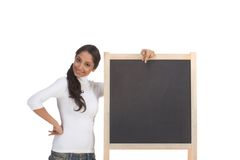 Template - ethnic Indian student by blackboard Royalty Free Stock Photo