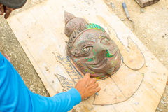 Template of garuda statue. Hands of the craftsman carve a bas-relief,template of garuda statue Royalty Free Stock Photo