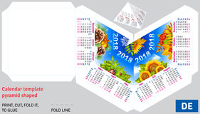 Template german calendar 2018 by seasons pyramid shaped. Vector background Stock Images