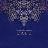 Template greeting card. Round gold mandala on blue background with texture and inscription. royalty free illustration
