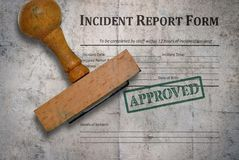 Incident report form. Template of an incident report form and wooden stamp on vintage background stock image