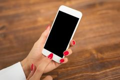 Template and mockup for mobile phone app design. Woman holding mobile phone Royalty Free Stock Photo
