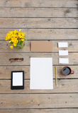 Template for photos, in Wooden floor is business cards, glasses, pencil, paper, flowers, Royalty Free Stock Photo