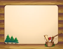 A template with pine trees and chopped woods Stock Photos