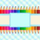 The template of the postcard or cover. Back to school. Template greeting card or cover: colored pencils on a fabric background in a cage; in the center place stock illustration