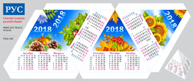 Template russian calendar 2018 by seasons pyramid shaped. Vector background Royalty Free Stock Photo