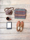 Template  sweater, shoes, camera, coffee, tablet,. Template for photos, in Wooden floor is a sweater, shoes, camera, coffee, tablet Stock Images