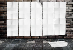 Template- Wall of Crumpled Posters on brick wall & footpath grou Royalty Free Stock Image