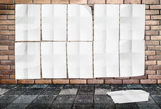 Template - Wall of Crumpled Posters on brick wall & footpath Royalty Free Stock Photo