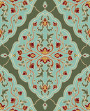 Template for wallpaper. Gentle, floral ornament. Template for oriental carpets, textiles, shawl and any surface. Seamless  pattern of gold contours on a green Stock Photography