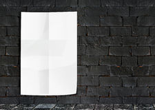 Template- White Crumple Poster on grunge brick wall & footpath g Royalty Free Stock Photo