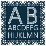 Templates for cutting out letters. Full English alphabet. May be used for laser cutting. Fancy lace letters. Font isolated blue background. A set of symbols in vector illustration