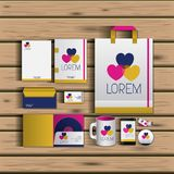 Templates of hearts of corporate stationery over wooden background. Vector illustration Royalty Free Stock Images