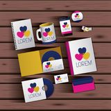 Templates of hearts of corporate stationery over wooden background. Vector illustration Stock Images
