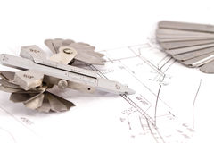 Templates for visual measurement control are on the drawing pipe Royalty Free Stock Photo