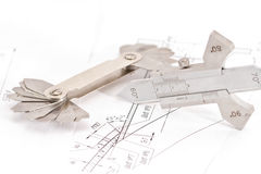 Templates for visual measurement control are on the drawing pipe Royalty Free Stock Images
