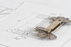 Templates for visual measurement control are on the drawing pipe Stock Photo