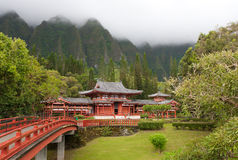 Temple. Oahu hawaii with red bridge and green mountains Royalty Free Stock Image
