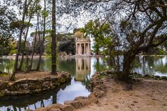 Temple of Aesculapios at Villa Borghese Gardens in Rome stock images
