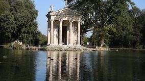 The lake of Villa Borghese, the temple of Aesculapius stock video